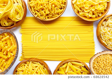 Different types of dry pasta on white. 68628542