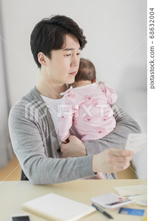 Modern young family concept, young mother and father with newborn 583 68632004