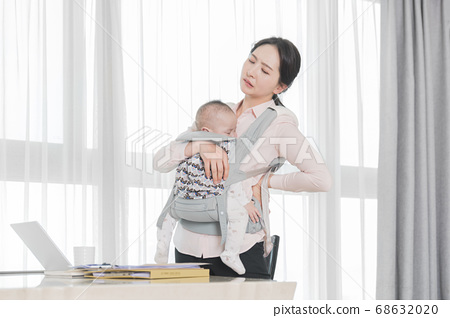 Modern young family concept, young mother and father with newborn 289 68632020