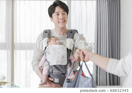 Modern young family concept, young mother and father with newborn 420 68632345