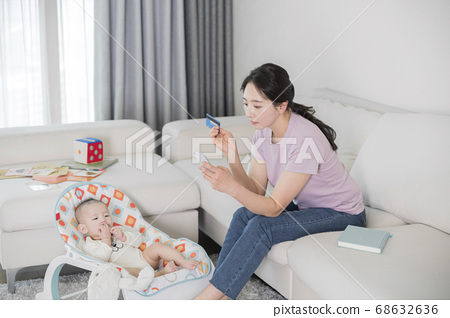 Modern young family concept, young mother and father with newborn 204 68632636