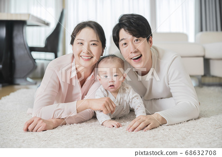 Modern young family concept, young mother and father with newborn 128 68632708
