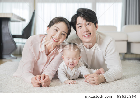 Modern young family concept, young mother and father with newborn 116 68632864