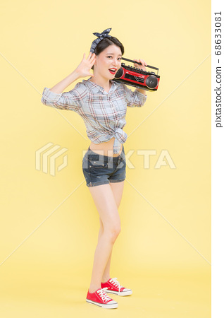 Life style concept, happy shopping time. Young asian woman with shopping bags and cart. 369 68633081
