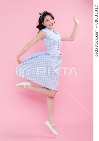 Life style concept, happy shopping time. Young asian woman with shopping bags and cart. 187 68633317