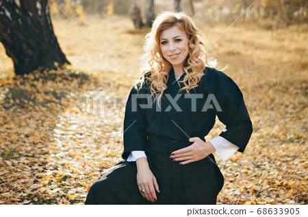 European woman in a kimono. a woman in the autumn forest. 68633905