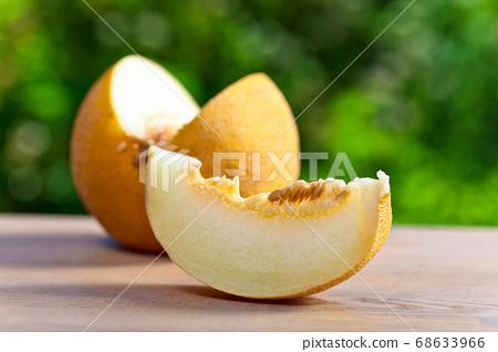 melon on table in garden 68633966