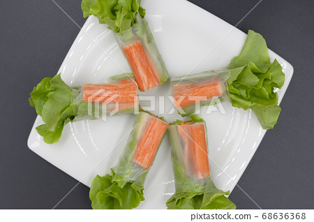Vegetable salad with crab sticks arranged in a 68636368