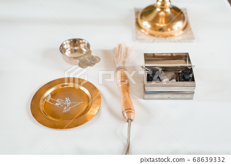 Set of priest for conducting the baptism ceremony in the Church 68639332
