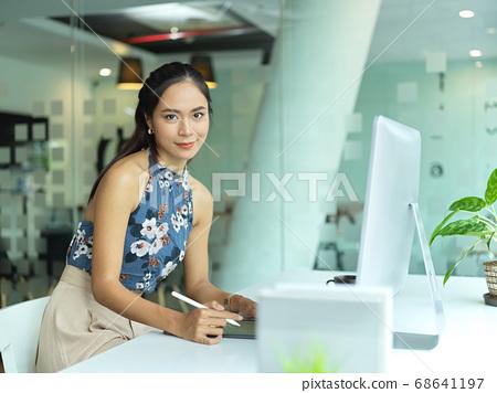 Portrait of female fashion designer smiling and 68641197