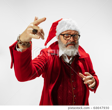Modern stylish Santa Claus in red fashionable suit isolated on white background 68647930