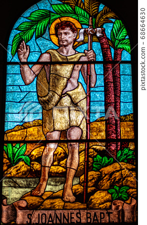 coloured stained glass of Saint John the Baptist 68664630