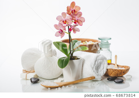 spa composition with beautiful pink orchid over white 68673814