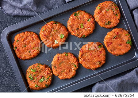 raw thai fish cakes on a baking sheet 68675854
