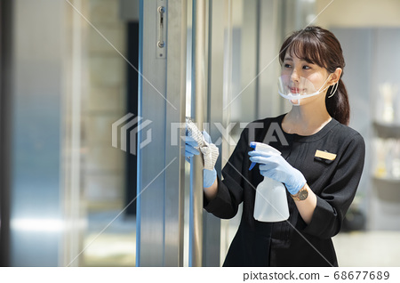 Woman disinfecting 68677689