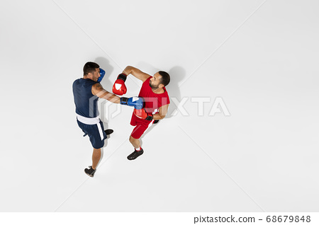Two professional boxers boxing isolated on white studio background, action, top view 68679848