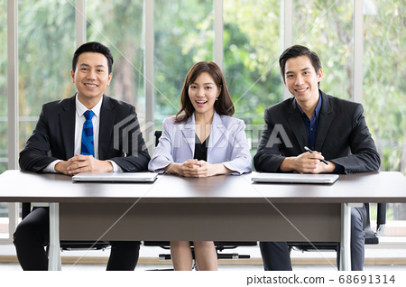 Group of business people looking at camera with smiles 68691314