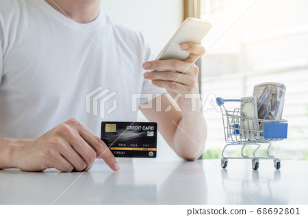 Young man people who hold credit cards and smartphones for online shopping 68692801