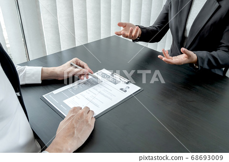 Business people hold a job profile and talk to job applicants for job interviews about careers 68693009