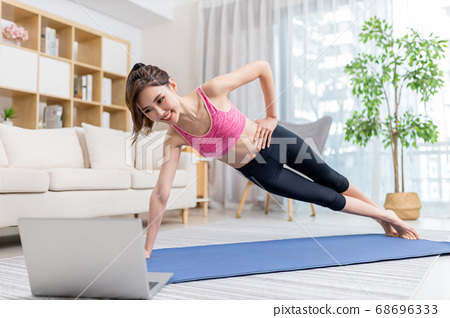 woman doing exercise at home 68696333