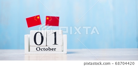 Wooden calendar of October 1st with miniature 68704420