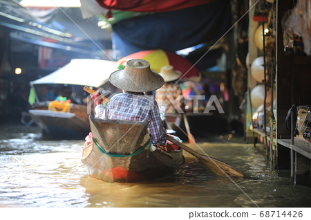 local vendor sell the product on the river in Damnoen Saduak Floating Market. 68714426