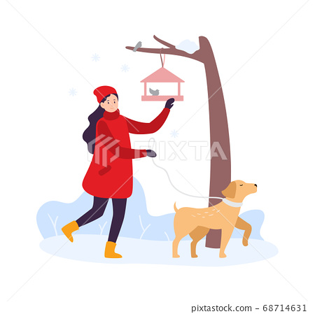 Winter activities. Girl walking with dog and feeding birds. Woman character in winter clothing with pet 68714631