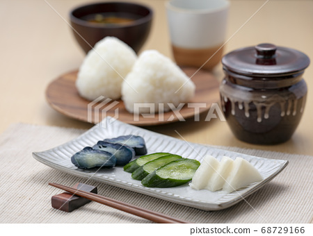Pickles and rice balls 68729166
