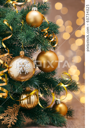 Christmas decoration with balls and ribbons. 68734825
