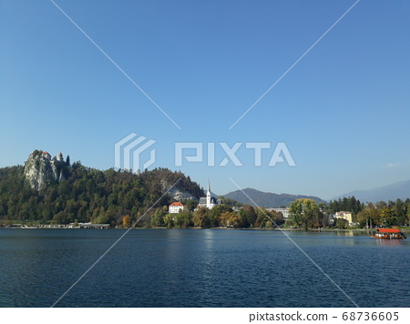 vast lakes and trees A castle on a green island. 68736605