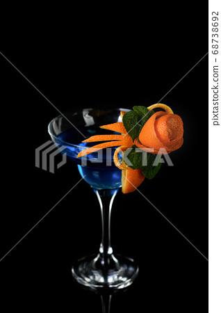 Art in orange- cocktail Blue lagoon 68738692