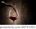 Red wine pouring into glass 68741061