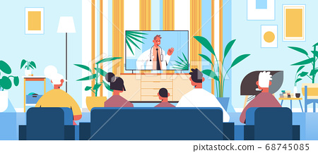 family watching online video consultation with male doctor on tv screen healthcare telemedicine medical advice 68745085