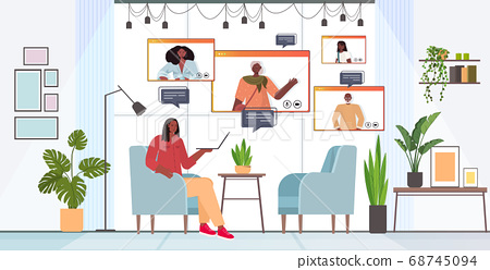 woman having virtual meeting with family members during video call online communication concept 68745094
