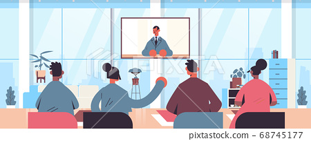 people watching online video consultation with male doctor on tv screen healthcare telemedicine medical advice 68745177