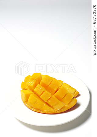 Mango of diced tropical fruits on a plate 68750570
