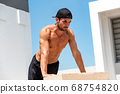 sportsman doing push up workout on wood box outdoors 68754820