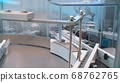 Glass bottles in production in the tray of an automatic liquid dispenser, a line for filling medicines against bacteria and viruses, antibiotics and vaccines 68762765
