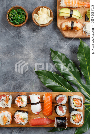 Sushi Set nigiri and sushi rolls on a wooden tray 68768718