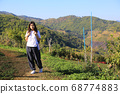 trekking girl in the countryside  68774883