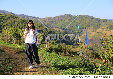 trekking girl in the countryside  68774883
