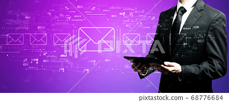 Email concept with businessman using his tablet 68776684