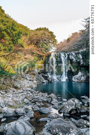 Cheonjeyeon waterfall in Jeju Island, Korea 68776791