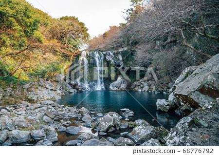 Cheonjeyeon waterfall in Jeju Island, Korea 68776792