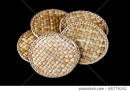 Rattan Coasters on a Black Background 68779202
