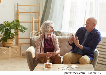 Senior Couple Enjoying Conversation at Home 68781570