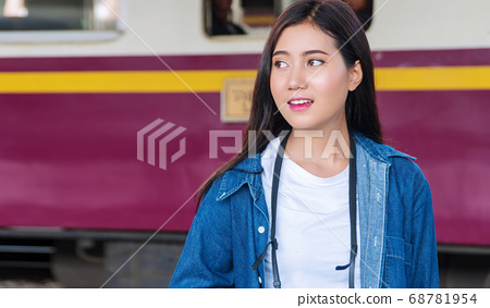 Travel transport concept. Attractive traveler girl 68781954