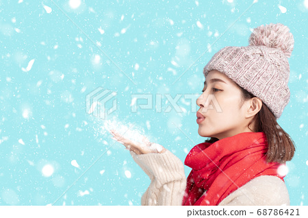 young woman in winter clothes and  Blowing Snow 68786421