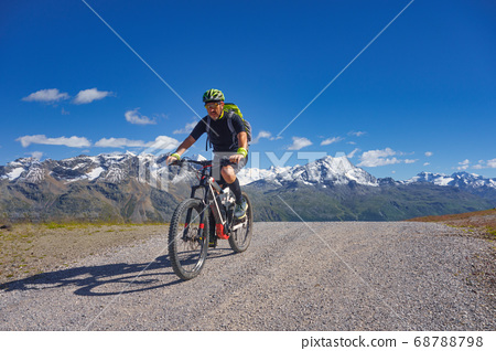 Mountain biking in the high mountains on a dirt 68788798