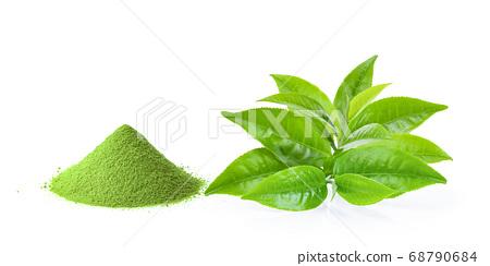tea leaves and green tea powder on white 68790684